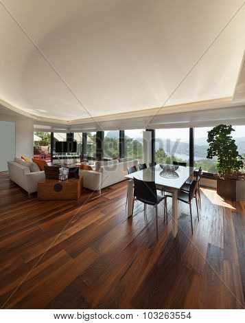 Interiors, wide modern living room of a luxury apartment