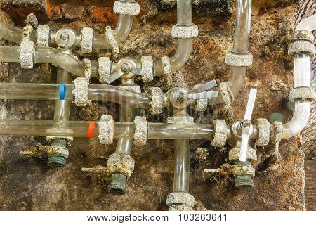 Closeup of old water supply tubes