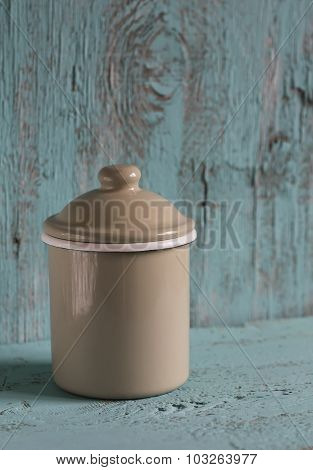 Enameled Jar  On A Blue Wooden Surface