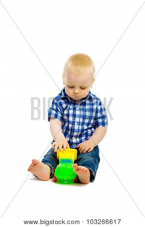 Baby Boy Playing With Toys. Isolated