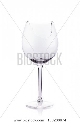 Broken glas of wine isolated on white background