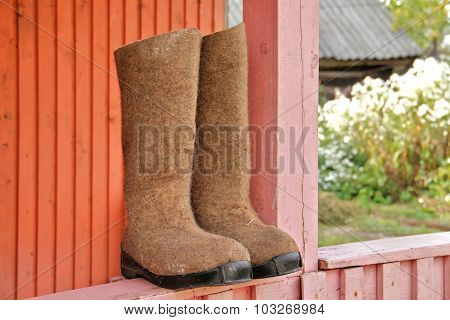 Durable Rural Russian High Boots Drying On Balcony