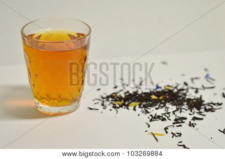 Cup of Earl Grey tea with leafs image.