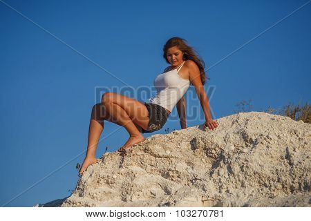 a woman of European appearance twenty years sitting on the mount