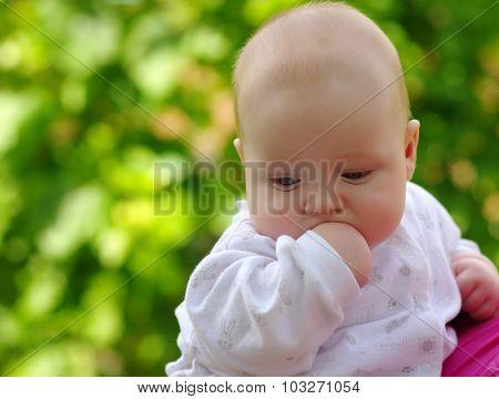 Portrait of baby boy on green bokeh background