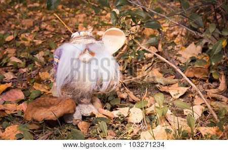 The Magic Little Man With A Wooden Spoon In The Autumn Wood Near A Mushroom