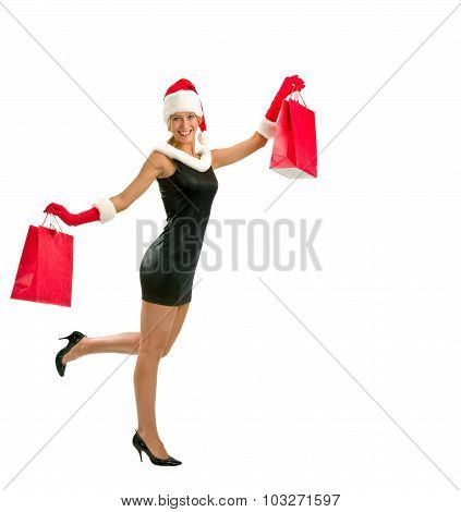 Happy Young Woman In A Dressed As Santa Claus With Shopping Bags