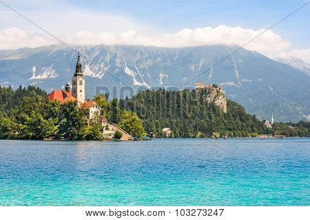Catholic Church On Island On Bled Lake And Bled Castle