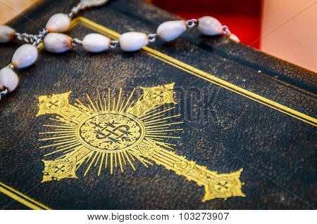 Artistic Vintage Edit Of An Antique Bible Or A Prayer Book With White Rosary Beeds