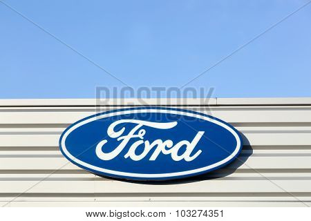 Ford logo on a facade of a dealer