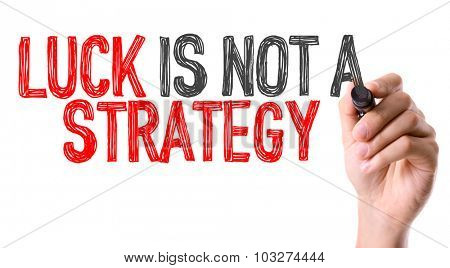 Hand with marker writing: Luck Is Not a Strategy