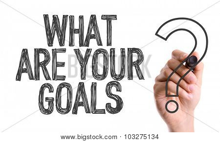 Hand with marker writing: What Are Your Goals?