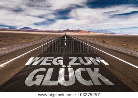 Road To Happiness (in German) written on desert road