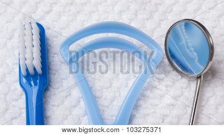 Blue Toothbrush With Dental Tools