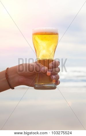 woman hand holding a refreshing beer