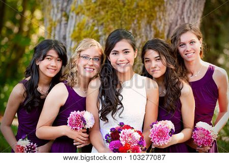 Beautiful Biracial Young Bride Smiling With Her Multiethnic Group Of Bridesmaids