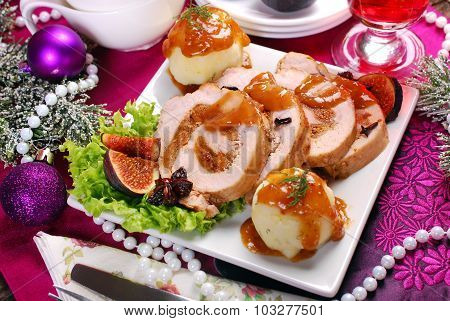 Christmas Dinner With Loin Of Pork Stuffed With Figs And Potato Balls