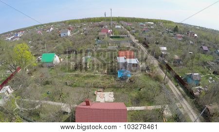 Houses  with gardens in small village at spring sunny day. Aerial view video frame