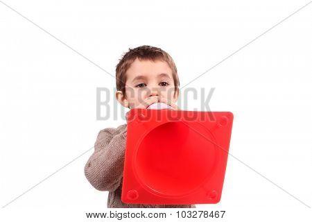 boy with orange traffic  cone