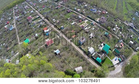 Small village among plants at spring sunny day. Aerial view video frame