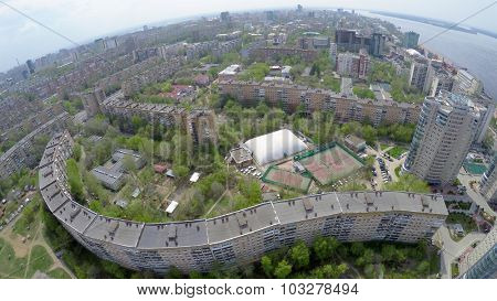 Urban sector on shore of Volga river at spring sunny day. Aerial view video frame