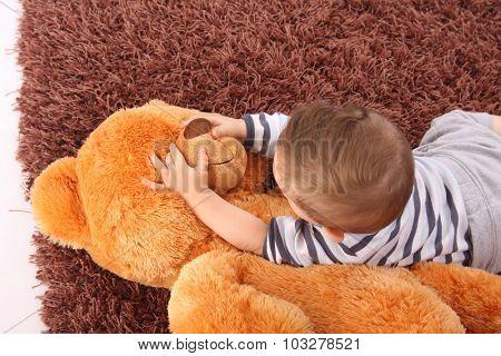 Little boy holding a teddy bear