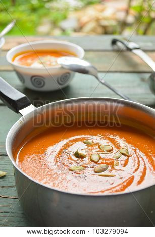 Vegetarian pumpkin-lentils cream soup with pepo seed