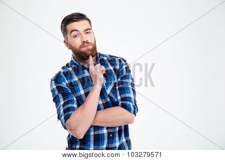 Portrait of a thoughtful man looking at camera isolated on a white background