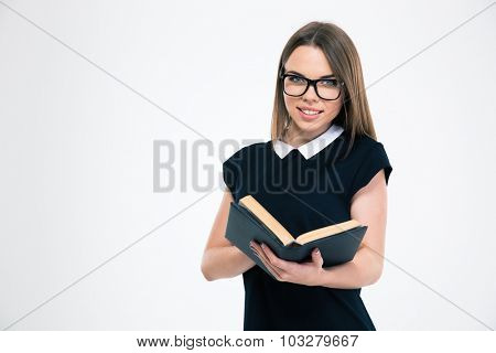 Portrait of a happy female girl holding book and looking at camera isolated on a white background
