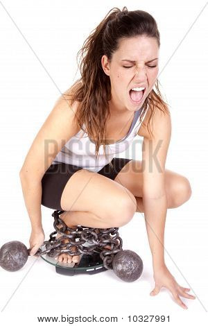 Woman Chained To Scales Screaming