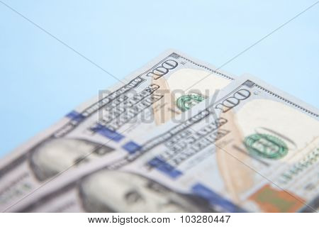 Two hundred dollar notes. All on blue background