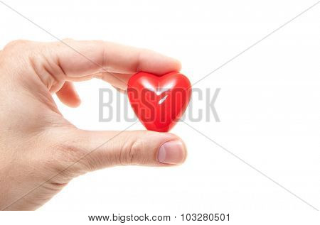 Hand holding red heart. All on white background
