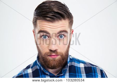 Portrait of a man with big eyes looking at camera isolated on a white background
