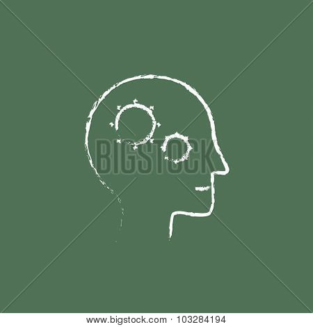 Human head with gear hand drawn in chalk on a blackboard vector white icon isolated on a green background.
