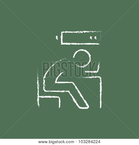 Businessman in low power hand drawn in chalk on a blackboard vector white icon isolated on a green background.