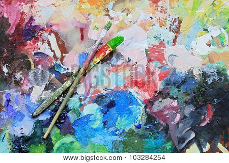 Art Brush And Knife On The Palette For Mixing Of The Paints