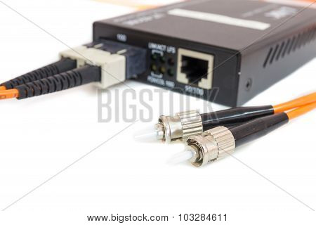 Close Up Metal Fiber Optic Cable In Front Media Converter