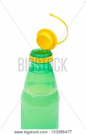 Plastic bottle with the lid open on a white background
