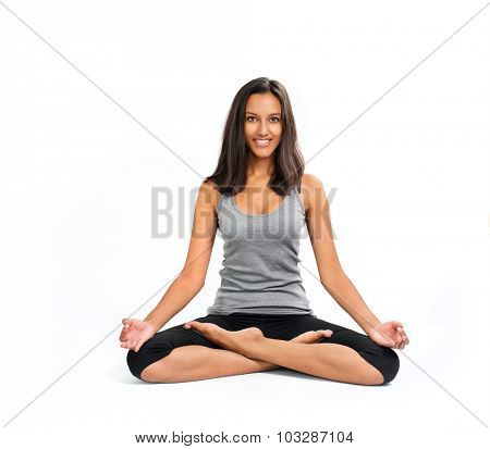 Long haired Beautiful smiling Woman doing a Yoga Lotus Pose (ansana). Isolated on white background.