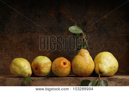 Organic pears on wooden shelf