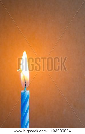 Burning Blue Candle  On The Table