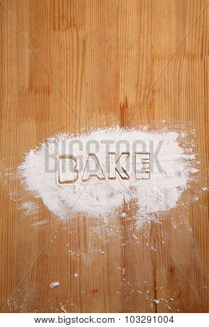 baking concept,flour on the wooden table with word BAKE