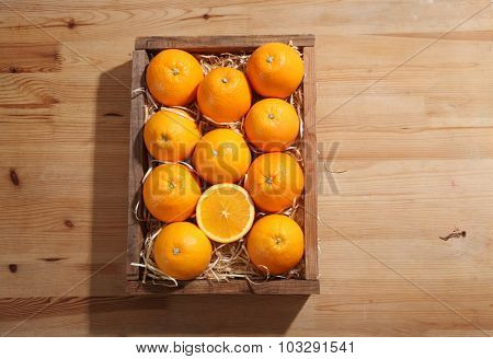 orange in the wooden crate