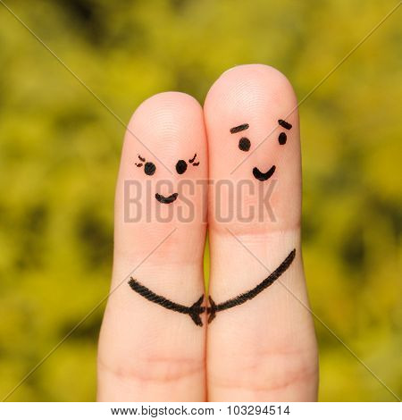 Finger art of a Happy couple. Happy couple holding hands on the background of yellow leaves
