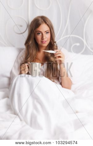 Beauty Woman Holding The Thermometer
