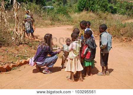 A Volunteer Female Doctor Speaks With African Children 62