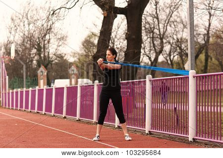 Young atheltic women working out in a park