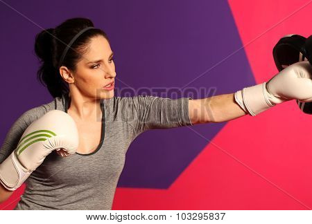 Female Boxer Punching And Wearing Boxing Gloves