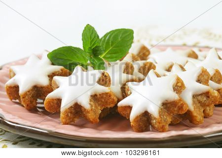 detail of christmas cookie stars with white sugar glaze