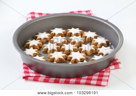 freshly baked christmas cookie stars, in the tray with fabric linen